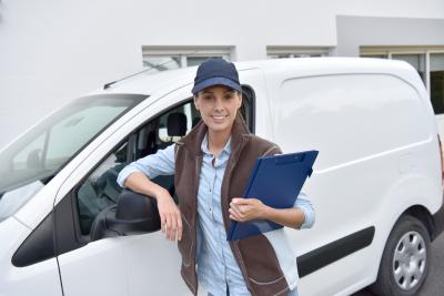 woman standing by van